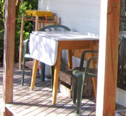 Relax in the sun with a wine on the deck outside the garden studio